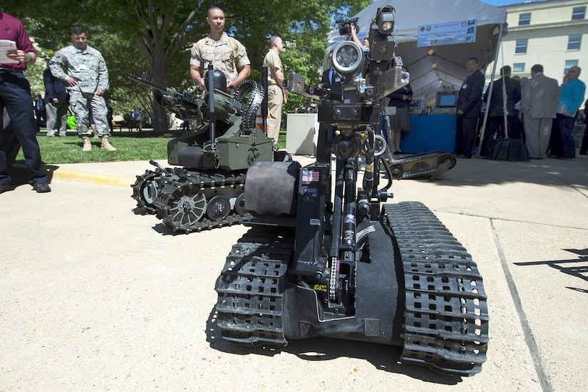 The Defense Department announced March 9, 2017, awards to 160 university researchers at 84 institutions totaling $47 million through the Defense University Research Instrumentation Program. Pictured here, Marine Corps Gunnery Sgt. Joseph Perara guides a robot during the Department of Defense Lab Day at the Pentagon, May 14, 2015. Perara is assigned to the Marine Warfighting Laboratory. DoD photo by EJ Hersom