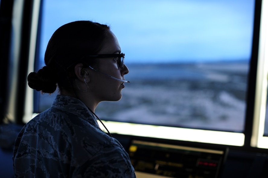 Senior Airman Iiae Hess, 355th Operations Support Squadron air traffic controller, monitors air traffic at Davis-Monthan Air Force Base, Ariz., Feb. 27, 2017. Hess plays a vital role in Davis-Monthan's daily operations by safely and efficiently managing the flow of aircraft through all aspects of flight. (U.S. Air Force photo by Airman 1st Class Nathan H. Barbour)