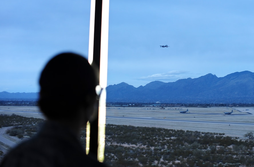 Senior Airman Iiae Hess, 355th Operations Support Squadron air traffic controller, monitors air traffic at Davis-Monthan Air Force Base, Ariz., Feb. 27, 2017. Hess was recently named Air Combat Command's Outstanding Airman of the Year in the Airman category for her personal and professional accomplishments. (U.S. Air Force photo by Airman 1st Class Nathan H. Barbour)