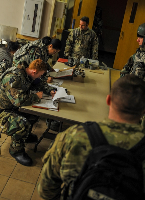 U.S. Air Force Senior Airman Dylan Williams and Staff Sgt. Toni Somera, 8th Force Support Squadron force management personalists, input information as they accept follow-on forces during exercise Beverly Pack 17-2, a no-notice training exercise at Kunsan Air Base, Republic of Korea, March 8, 2017.  Kunsan airmen provide combat capabilities alongside Republic of Korea partners by participating in training, inspections and exercises throughout the year to enhance communication and interoperability between military forces so they are prepared to fight as a combined force. (U.S. Air Force photo by Senior Airman Colville McFee/Released)