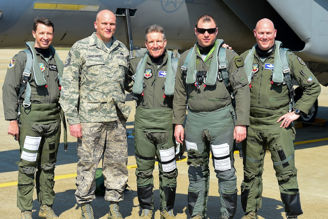 "Photo of U.S. Air Force Gen. Herbert ""Hawk"" Carlisle,  with fellow pilots and his former crew chief, before his final flight"