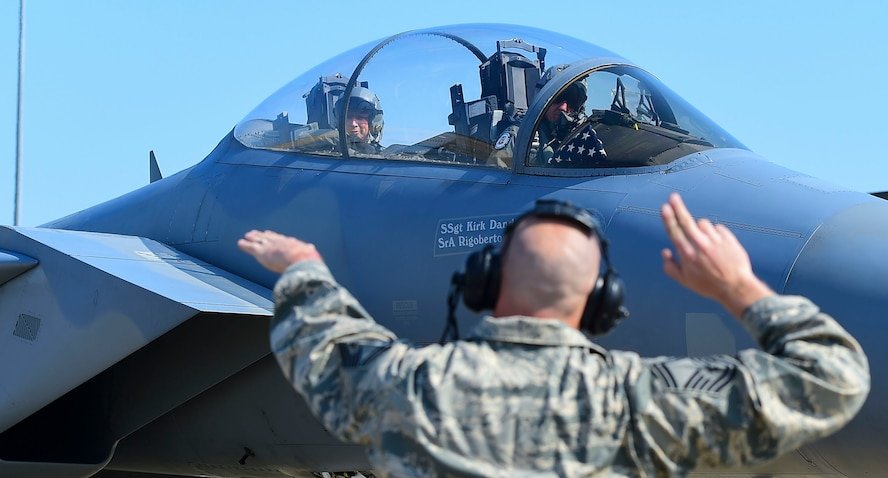 """U.S. Air Force Senior Master Sgt. Jeffrey Zimmerman, 75th Aircraft Maintenance Unit superintendent, assigned to Moody Air Force Base, Ga., guides U.S. Air Force Gen. Herbert """"Hawk"""" Carlisle, commander of Air Combat Command, as he prepares to takeoff on his final flight at Joint Base Langley-Eustis, Va., March 9, 2017. Carlisle has logged more than 3,600 flight hours in numerous air frames throughout his career. (U.S. Air Force photo/Airman 1st Class Derek Seifert)"""