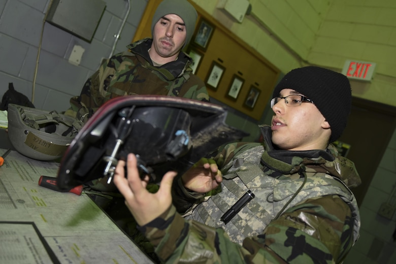 U.S. Air Force Airman 1st Class Seth Rojas and Airman 1st Class Michael Lubick, 8th Logistics Readiness Squadron fire truck and refueller mechanics, inspect a taillight during exercise Beverly Pack 17-2, a no-notice exercise at Kunsan Air Base, Republic of Korea, March 7, 2017. Rojas and Lubick ensure parts are installed properly to keep the Pack moving in support of the 8th Fighter Wing mission. (U.S. Air Force photo by Senior Airman Michael Hunsaker/Released)