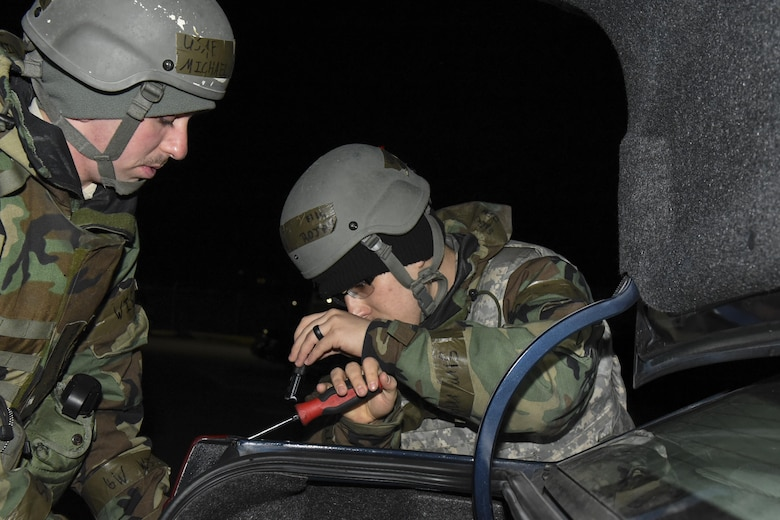 U.S. Air Force Airman 1st Class Seth Rojas and Airman 1st Class Michael Lubick, 8th Logistics Readiness Squadron fire truck and refueller mechanics, replace a hazard light on a vehicle during exercise Beverly Pack 17-2, a no-notice training exercise at Kunsan Air Base, Republic of Korea, March 7, 2017. Maintaining vehicles is one part of the larger 8th LRS mission; to keep the Pack moving as we Defend the Base, Accept Follow-On Forces, and Take the Fight North. (U.S. Air Force photo by Senior Airman Michael Hunsaker/Released)