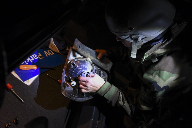 U.S. Air Force Airman 1st Class Michael Lubick, 8th Logistics Readiness Squadron fire truck and refueller mechanic, removes a bulb from a taillight during exercise Beverly Pack 17-2, a no-notice training exercise at Kunsan Air Base, Republic of Korea, March 7, 2017. Lubick is responsible for maintaining vehicles to ensure airmen can perform their daily tasks in support of the 8th Fighter Wing mission. (U.S. Air Force photo by Senior Airman Michael Hunsaker/Released)