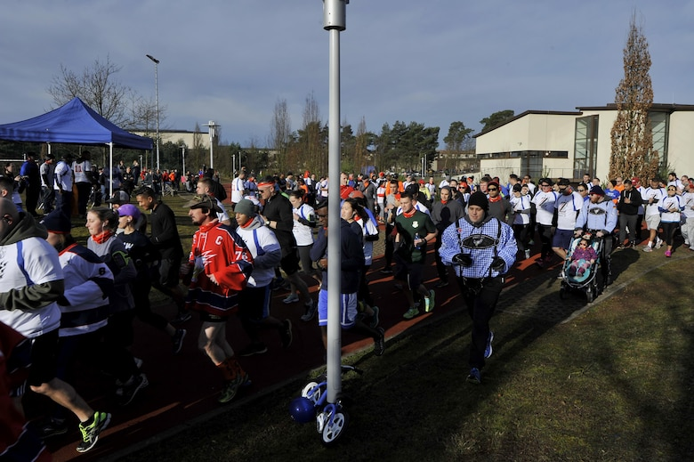 The starting horn sounds and runners take off as the 6th annual memorial 5K in honor of Airman 1st Class Zachary Cuddeback begins on Ramstein Air Base, Germany, Mar. 4, 2017. Airman Cuddeback's life was taken during a routine air crew run at Frankfurt International Airport in March of 2011. (U.S. Air Force photo by Airman 1st Class D. Blake Browning)