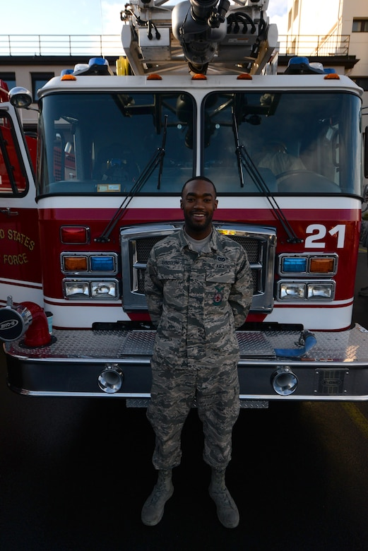 Airman Gregg Randolph, 86th Civil Engineer Squadron firefighter, poses for a photo outside Fire Station one on Ramstein Air Base, Germany, Mar. 7, 2017. A certified first responder, Randolph understood the sense of urgency required in an emergency situation he encountered on his way home one night. (U.S. Air Force photo by Airman 1st Class D. Blake Browning)