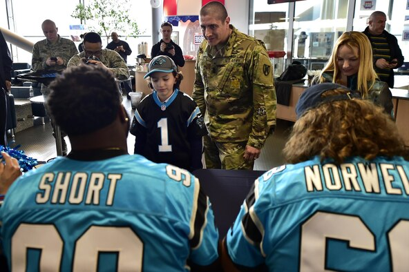Carolina Panthers sign autographs for fans during a meet and greet at the 721st Aerial Port Squadron's Passenger Terminal on Ramstein Air Base, Germany, March 6, 2017. Panther's players flew to Germany as part of the United Service Organization's efforts to improve the lives of service members across the world. (U.S. Air Force photo by Senior Airman Jonathan Bass)