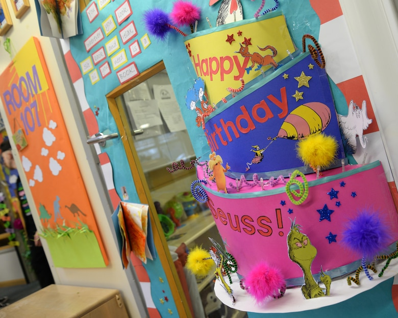 Doors are decorated to celebrate Dr. Seuss' birthday at the RAF Mildenhall, England, Child Development Center March 3, 2017. Team Mildenhall commanders voted on the various designed doors and read to children. (U.S. Air Force photo by Senior Airman Justine Rho)