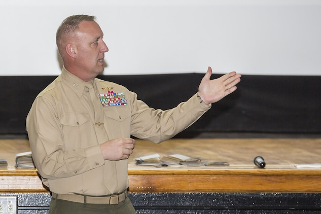 Col. Peter Buck speaks at the Career Development Information Forum at the Lasseter Theater aboard Marine Corps Air Station Beaufort, March 6. The forum was held to educate Civilian Marines about the programs available to them to ensure they are fully trained to expand their careers and complete their mission. Buck invited them to engage, participate and take advantage of the forum. Buck is the commanding officer of MCAS Beaufort.