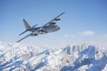 A C-130 Hercules, from Alaska Air National Guard's 144th Airlift Squadron, flies over Denali National Park and Preserve, Alaska, March 4, 2017. After 41 years of flying the C-130, the squadron's eight C-130s were divested, with the planes either being transferred to outside units or retired from service. The unit's last two aircraft departed Joint Base Elmendorf-Richardson, Alaska, the following day. (U.S. Air National Guard photo/Staff Sgt. Edward Eagerton)