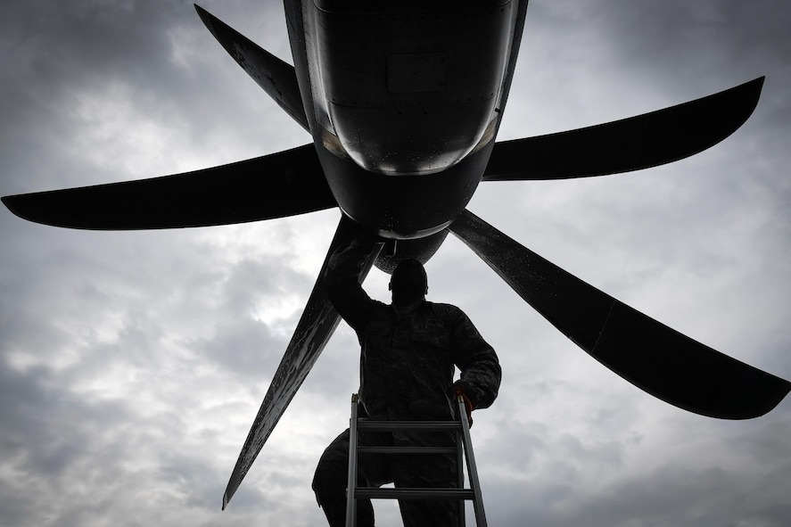 Tech. Sgt. Rainier Howard, 374th Aircraft Maintenance Squadron crew chief, performs preflight inspection of a C-130J Super Hercules at Kadena Air Base, Japan, March 6, 2017. This is the first C-130J to be assigned to Pacific Air Forces. Yokota serves as the primary Western Pacific airlift hub for U.S. Air Force peacetime and contingency operations. Missions include tactical air land, airdrop, aeromedical evacuation, special operations and distinguished visitor airlift. (U.S. Air Force photo by Staff Sgt. Michael Smith)