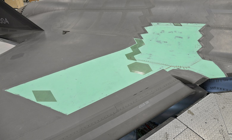 The last Structural Life Limiting Parts (SLLP) program F-35 forward wing root rib modification area is shown in primer paint prior to having low observable material reapplied. Removal of parts from this section were needed to gain access for the modification. (U.S. Air Force photo by Alex R. Lloyd)