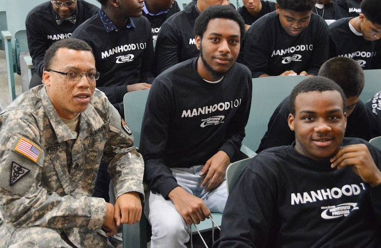 U.S. Army Reserve Staff Sgt. Paul Word, 300th Sustainment Brigade, sits with young men participating in a Steve and Marjorie Harvey Foundation Mentoring Camp in Dallas, TX, on Feb. 4, 2017.  Staff Sgt. Word was selected to mentor a group of young men throughout the event. For the past six years the U.S. Army Reserve has partnered with the Steve and Marjorie Harvey Foundation to provide Soldier-mentors for camps around the country. (U.S. Army Reserve Photo by Maj. Brandon R. Mace)