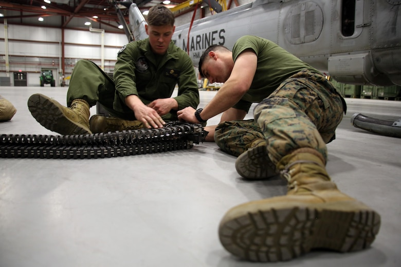 Lance Cpl. Collin Stewart (left) and Pfc. Stetson Kirkpatrick (right) repair a piece of ordnance equipment from a UH-1Y Venom aboard Ft. Drum, N.Y., Mar. 9, 2017. Marines with Marine Light Attack Helicopter Squadron 269, Marine Aircraft Group 29, 2nd Marine Aircraft Wing arrived at Ft. Drum Mar. 8, and will spend more than a week conducting aerial operations in the cold environment. The training will also offer the Marines a unique opportunity to come out of their comfort zone and build unit cohesion. Stewart and Kirkpatrick are aviation ordnance technicians assigned to HMLA-269. (U.S. Marine Corps photo by Cpl. Mackenzie Gibson/Released)