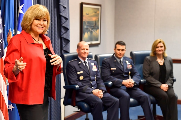 Sharon O'Malley-Burg, daughter of Gen. Jerome O'Malley, helps Gen. Stephen Wilson, the Air Force Vice Chief of Staff, present the 2016 O'Malley Award to Col. John Wagner and his wife, Jennifer, during a Pentagon ceremony, March 7, 2017. The Wagners earned the award for their work at Buckley Air Force Base. Colo. (U.S. Air Force photo/Scott M. Ash)