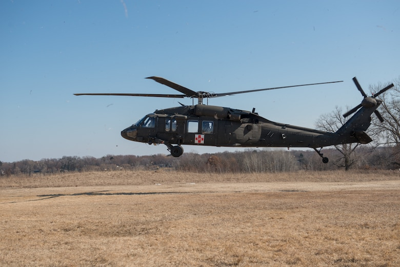 A UH-60 Blackhawk helicopter takes off after being loaded with a simulated injured service member during a joint service medical evacuation training on March 4th, 2017 at Arden Hills Army Training Site. (U.S. Air Force photo by Senior Airman Samuel Wacha)