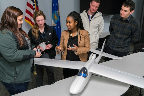 Adrienne Ephrem talks with students Morgan Oldham, Wright State University; Caitlyn Jenner, University of Dayton; Jamie Workman, Wright State University; and John Wintersohle, Wright State University about their AFRL joint unmanned aerial system project. They will use the Super Sky Surfer with a 94-inch wing span. (U.S. Air Force photo/Kwame Acheampong)