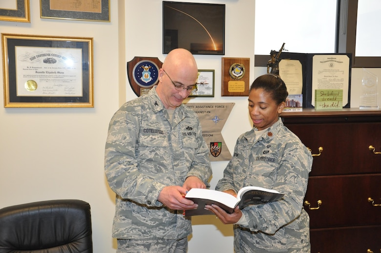Col. Paul Cotellesso, Air University Detachment 1 Commander/ Director of Staff at the Air Force Institute of Technology, reviews a section of the Uniform Code of Military Justice with Maj. Jeanette Skow, AFIT Staff Judge Advocate. (U.S. Air Force photo/Bryan Ripple)