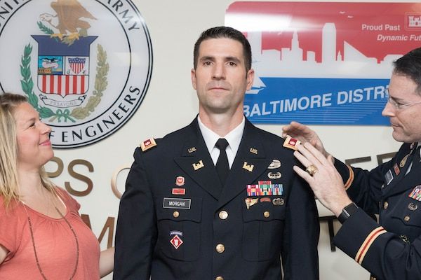 Col. Ed Chamberlayne, Baltimore District commander, places shoulder boards with the rank of lieutenant colonel on Lt. Col. Brad Morgan, Baltimore District deputy commander, during a promotion ceremony from major to lieutenant colonel at the District Headquarters in Baltimore, March 1, 2017. Morgan's wife Rebecca is also pictured. (U.S. Army photo by Alfredo Barraza)