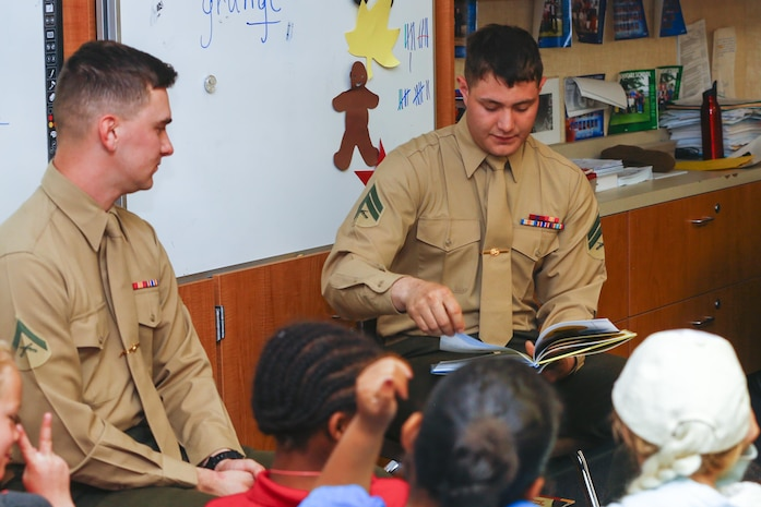 Cpl. Martin Strzyk, joint fires observer, 3rd Battalion, 4th Marines, 7th Marine Regiment, reads a Dr. Seuss book to a first grade class at Palm Vista Elementary School in Twentynine Palms, Calif., as part of Read Across America Day, March 3, 2017. The battalion recently adopted the school and the unit volunteers to participate in many of the schools' events. (U.S. Marine Corps photo by Cpl. Thomas Mudd)