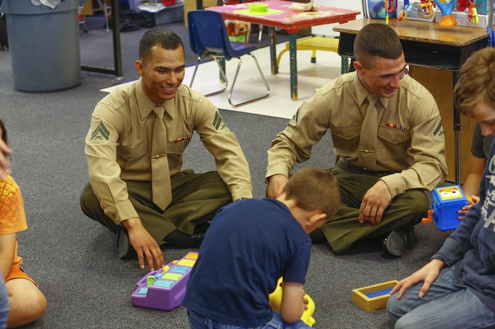 Cpl. Michael Caceres, maintenance management specialist, and Lance Cpl. Gavin McDougle, motor transportation mechanic, 3rd Battalion, 4th Marines, 7th Marine Regiment, talk and play with Palm Vista Elementary School students in Twentynine Palms, Calif., March 3, 2017. The battalion recently adopted the school and the unit volunteers to participate in many of the schools' events. (U.S. Marine Corps photo by Cpl. Thomas Mudd)