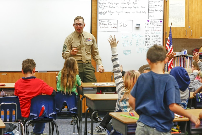 Gunnery Sgt. Aaron Sipp, fires chief, 3rd Battalion, 4th Marines, 7th Marine Regiment, answers students' questions at Palm Vista Elementary School in Twentynine Palms, Calif., as part of Read Across America Day, March 3, 2017. The battalion recently adopted the school and the unit volunteers to participate in many of the schools' events. (U.S. Marine Corps photo by Cpl. Thomas Mudd)