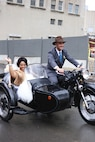 U.S. Air Force Capt. Renee Cassidy, the 509th Maintenance Operations officer in charge, and Capt. Justin Cassidy, the 13th Aircraft Maintenance Unit officer in charge, depart on their motorcycle following a vow renewal ceremony in Kansas City, Mo., May 2015. (Courtesy photo)
