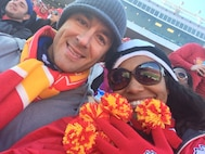 U.S. Air Force Capt. Justin Cassidy, the 13th Aircraft Maintenance Unit officer in charge, and Capt. Renee Cassidy, the 509th Maintenance Operations officer in charge, display their team spirit during a Kansas City Chiefs' football game in Kansas City, Mo., in 2015. The Cassidys met while stationed at Ellsworth Air Force Base, S.D., in 2009. Fast-forward eight years, the joint-military couple is currently stationed at Whiteman Air Force Base, Mo., raising their son, Carson, and preparing to purchase their first home together. (Courtesy photo)