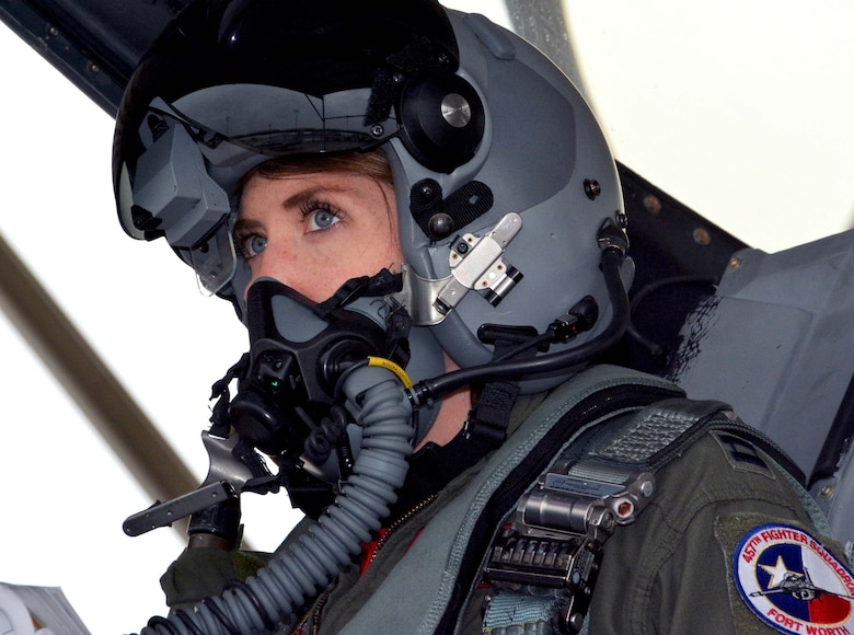"""Capt. Michelle """"Mace"""" Curran, 355th Fighter Squadron F-16 pilot, looks up during fighter jet launch preparations on the flightline, Mar. 4, 2017. Curran was the first woman assigned to fly in the 355th FS and attributed her success to her parents, leadership and strong women in aviation past and present who've helped pave the way. (U.S. Air Force photo by Staff Sgt. Samantha Mathison)"""