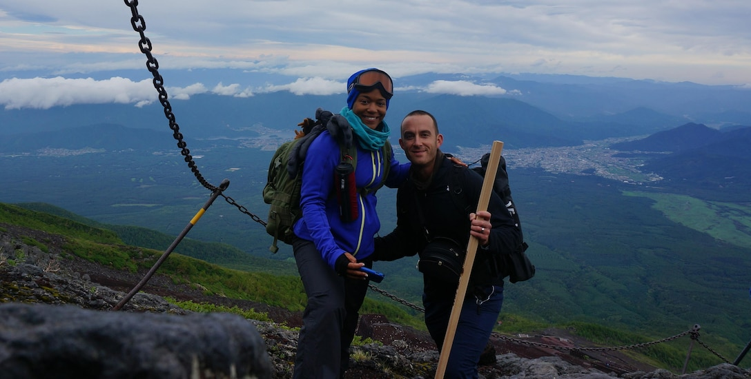 U.S. Air Force Capt. Justin Cassidy, the 13th Aircraft Maintenance Unit officer in charge, and Capt. Renee Cassidy, the 509th Maintenance Operations officer in charge, trek up Mount Fuji for wedding photos in Okinawa, Japan, May 2013. (Courtesy photo)