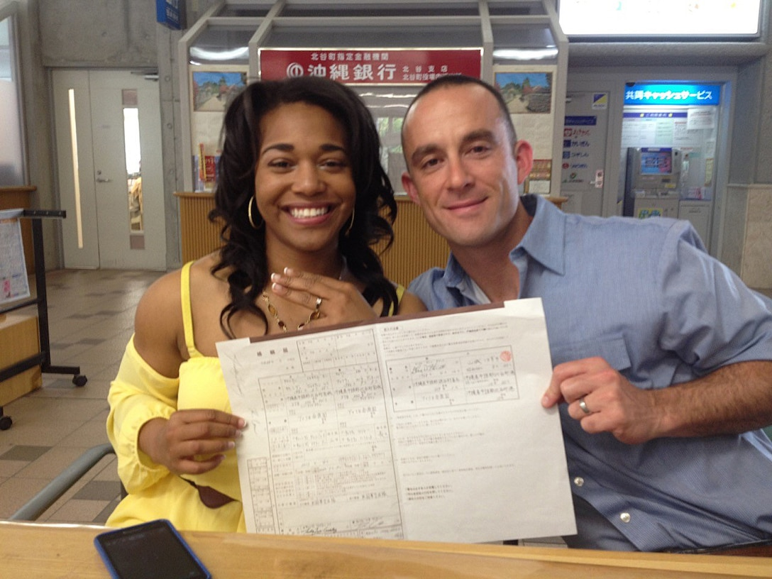 U.S. Air Force Capt. Renee Cassidy, the 509th Maintenance Operations officer in charge, and Capt. Justin Cassidy, the 13th Aircraft Maintenance Unit officer in charge, display their wedding certificate, written in Kanji, after getting married in Okinawa, Japan, May 2013. The Cassidys began long-distance dating in 2012 and were officially married in May 2013. Joint-spouse orders reunited the couple at Whiteman Air Force Base, Mo., in 2014. (Courtesy photo)