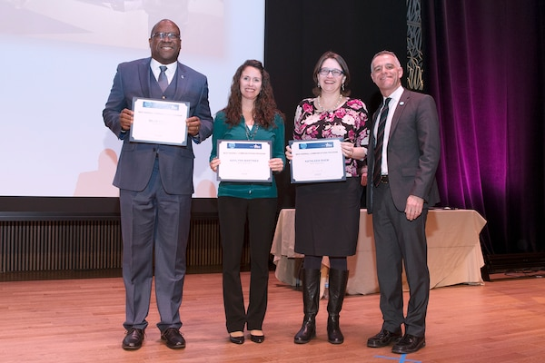 (From left) DLA Human Resources Deputy Director Billie Keeler; Kaylynn Martin, assistant campaign manager for the 2016 DLA Combined Federal Campaign; Kathy Rhem, DLA Human Resources communications manager and 2016 DLA CFC campaign manager; and Bruce Alexander, a member of the Local Federal Coordinating Committee that oversees CFC of the National Capital Area, pose for a photo at the CFCNCA 2016 Finale and Awards Program March 3 at the National Museum of African American Heritage and Culture.