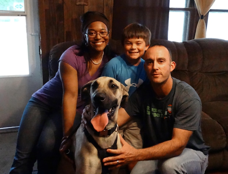 U.S. Air Force Capt. Justin Cassidy, the 13th Aircraft Maintenance Unit officer in charge, and Capt. Renee Cassidy, the 509th Maintenance Operations officer in charge, gather for a family photo with their son, Carson, and their Great Dane. (Courtesy photo)