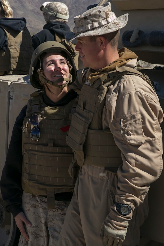 Amanda Boos, wife of Capt. Jonathon Boos, 1st Tank Battalion, talks to her husband during the battalion's Jane Wayne Day at Range 500 aboard Marine Corps Air Ground Combat Center, Twentynine Palms, Calif., March 2, 2017. The event is held to bolster unit cohesion while allowing the spouses to see what their Marines and sailors do on a daily basis. (U.S. Marine Corps photo by Cpl. Julio McGraw)
