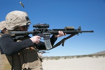 Codi Trifiro, wife of Lance Cpl. Shane Trifiro, 1st Tank Battalion, shoots an M4 Carbine during the battalion's Jane Wayne Day at Range 500 aboard Marine Corps Air Ground Combat Center, Twentynine Palms, Calif., March 2, 2017. The event is held to bolster unit cohesion while allowing the spouses to see what their Marines and sailors do on a daily basis. (U.S. Marine Corps photo by Cpl. Julio McGraw)
