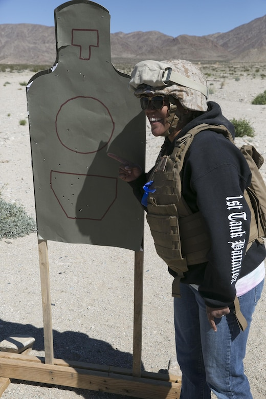 Vivid Linares, wife of Staff Sgt. Samuel Linares, supply chief, 1st Tank Battalion, displays her shot group during the battalion's Jane Wayne Day at Range 500 aboard Marine Corps Air Ground Combat Center, Twentynine Palms, Calif., March 2, 2017. The event is held to bolster unit cohesion while allowing the spouses to see what their Marines and sailors do on a daily basis. (U.S. Marine Corps photo by Cpl. Julio McGraw)