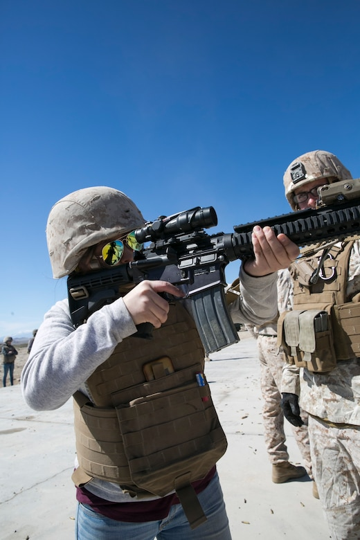Kimberle Aponte, wife of Lance Cpl. Andrew Aponte, tank gunner, 1st Tank Battalion, shoots an M4 Carbine during the battalion's Jane Wayne Day at Range 500 aboard Marine Corps Air Ground Combat Center, Twentynine Palms, Calif., March 2, 2017. The event is held to bolster unit cohesion while allowing the spouses to see what their Marines and sailors do on a daily basis. (U.S. Marine Corps photo by Cpl. Julio McGraw)