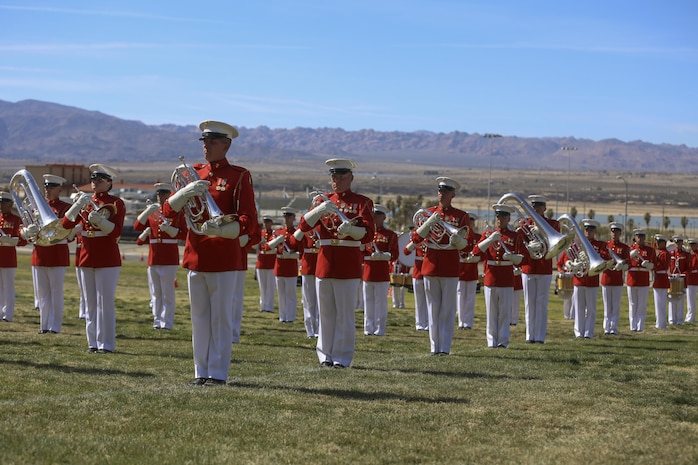 """The U.S. Marine Corps Drum & Bugle Corps celebrates the historic pride of the Marine Corps through music and ceremonial drill, during the Battle Color Ceremony at Lance Cpl. Torrey L. Gray Field aboard Marine Corps Air Ground Combat Center, Twentynine Palms, Calif., March 8, 2017. The U.S. Marine Corps Battle Color Detachment travels worldwide annually to demonstrate the discipline and """"Esprit de Corps"""" of Marines. (U.S. Marine Corps photo by Lance Cpl. Natalia Cuevas)"""