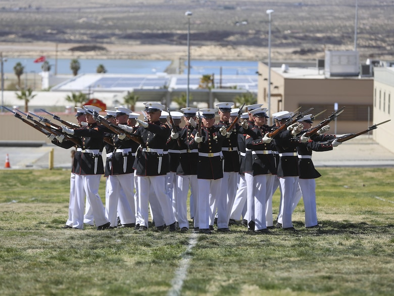"""The U.S. Marine Corps Silent Drill team exemplifies the pride and professionalism of the Marine Corps during the Battle Color Ceremony at Lance Cpl. Torrey L. Gray Field aboard Marine Corps Air Ground Combat Center, Twentynine Palms, Calif., March 8, 2017. The U.S. Marine Corps Battle Color Detachment travels worldwide annually to demonstrate the discipline and """"Esprit de Corps"""" of Marines. (U.S. Marine Corps photo by Lance Cpl. Natalia Cuevas)"""