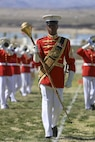"""Master Gunnery Sgt. Kevin Buckles, drum major, U.S. Marine Corps Drum & Bugle Corps, leads """"The Commandant's Own"""" during the Battle Color Ceremony at Lance Cpl. Torrey L. Gray Field aboard Marine Corps Air Ground Combat Center, Twentynine Palms, Calif., March 8, 2017. The U.S. Marine Corps Battle Color Detachment travels worldwide annually to demonstrate the discipline and """"Esprit de Corps"""" of Marines. (U.S. Marine Corps photo by Lance Cpl. Natalia Cuevas)"""
