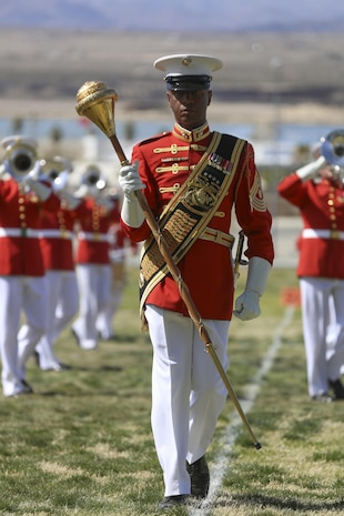 "Master Gunnery Sgt. Kevin Buckles, drum major, U.S. Marine Corps Drum & Bugle Corps, leads ""The Commandant's Own"" during the Battle Color Ceremony at Lance Cpl. Torrey L. Gray Field aboard Marine Corps Air Ground Combat Center, Twentynine Palms, Calif., March 8, 2017. The U.S. Marine Corps Battle Color Detachment travels worldwide annually to demonstrate the discipline and ""Esprit de Corps"" of Marines. (U.S. Marine Corps photo by Lance Cpl. Natalia Cuevas)"