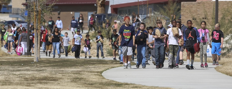 Fourth and fifth-grade students from Palm Vista Elementary school arrive at Victory Park to have lunch with Marines from 3rd Battalion, 4th Marines, 7th Marine Regiment following the annual Battle Color Ceremony at Lance Cpl. Torrey L. Gray Field aboard Marine Corps Air Ground Combat Center, Twentynine Palms, Calif., March 8, 2017. 3-4 adopted the elementary school in order to mentor the children.  (U.S. Marine Corps photo by Lance Cpl. Natalia Cuevas)