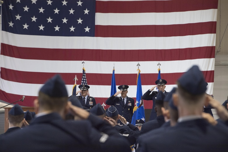 U.S. Air Force Chief of Staff Gen. David L. Goldfein, General Hawk Carlisle, former commander, Air Combat Command, and Gen. James M. Holmes, Commander, ACC, salute during ACC's Change of Command ceremony at Joint Base Langley-Eustis, Va., March 10, 2017. Holmes assumed command from Carlisle, who retired after 39 years of service to the Air Force. (U.S. Air Force photo by Staff Sgt. Nick Wilson)