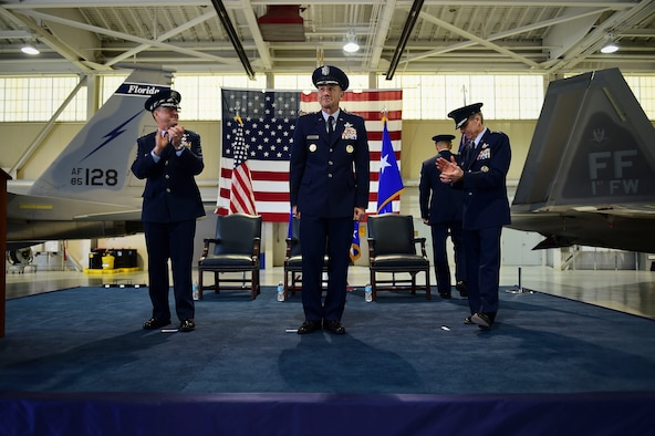 "Air Force Chief of Staff Gen. David L. Goldfein and Gen. Herbert ""Hawk"" Carlisle, the outgoing commander of Air Combat Command, applaud for Gen. James M. Holmes, the commander of ACC, during ACC's change of command ceremony at Joint Base Langley-Eustis, Va., March 10, 2017. Holmes assumed command from Carlisle, who retired after 39 years of service to the Air Force. (U.S. Air Force photo/Senior Airman Kimberly Nagle)"