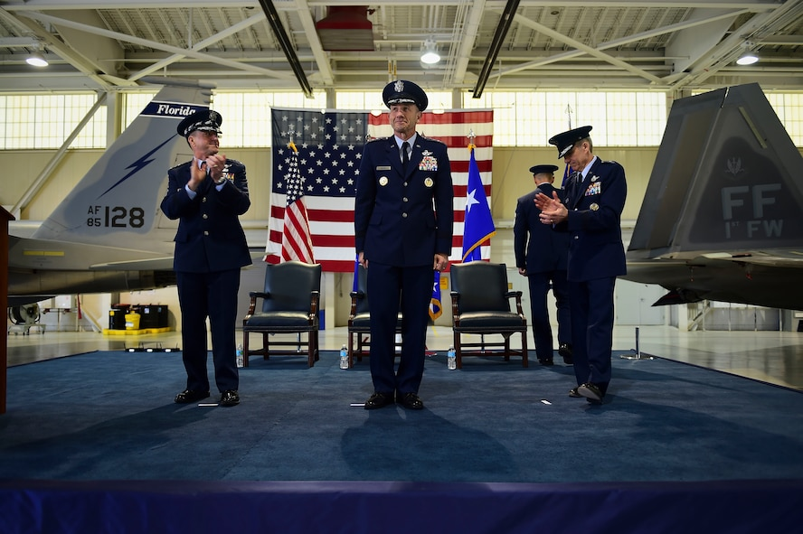 U.S. Air Force Chief of Staff Gen. David L. Goldfein, and General Hawk Carlisle, former commander, Air Combat Command, lead an applause for Gen. James M. Holmes, Commander, ACC, during ACC's Change of Command ceremony at Joint Base Langley-Eustis, Va., March 10, 2017. Holmes assumed command from Carlisle, who retired after 39 years of service to the Air Force. (U.S. Air Force photo by Senior Airman Kimberly Nagle)