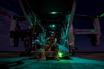 A special missions aviator from the 8th Special Operation Squadron rest on the ramp of a CV-22 Osprey at Avon Park, Fla., on March 7, 2017 during Emerald Warrior 17. Emerald Warrior is a U.S. Special Operations Command exercise during which joint special operations forces train to respond to various threats across the spectrum of conflict. (U.S. Air Force photo/Airman 1st Class Keifer Bowes)