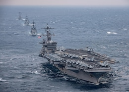 The aircraft carrier USS Carl Vinson (CVN 70), foreground, transits the East China Sea with the Japan Maritime Self-Defense Force Takanami-class destroyer JS Sazanami (DD 113), middle first, the Japan Maritime Self-Defense Force Murasame-class destroyer JS Samidare (DD 106), middle second, and the Arleigh Burke-class guided-missile destroyer USS Wayne E. Meyer (DDG 108) Mar. 9, 2017. The Carl Vinson Carrier Strike Group is on a regularly scheduled Western Pacific deployment as part of the U.S. Pacific Fleet-led initiative to extend the command and control functions of U.S. 3rd Fleet. U.S. Navy aircraft carrier strike groups have patrolled the Indo-Asia-Pacific regularly and routinely for more than 70 years.
