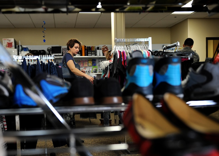 Customers browse for clothes and other items March 7, 2017, at the Airman's Attic on Little Rock Air Force Base, Ark. Families are encouraged to continue the cycle of giving, by donating items to ease the transition of moving for other families. (U.S. Air Force photo by Airman 1st Class Grace Nichols)
