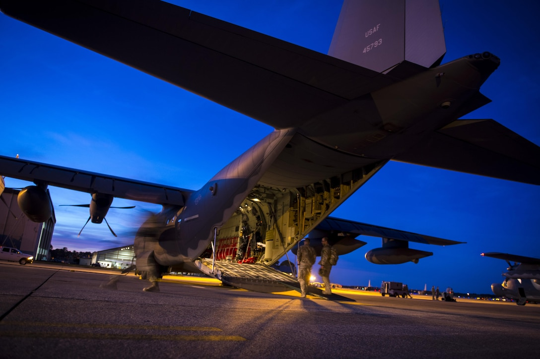 Surgical Team medics from the 720th Operations Support Squadron board an MC-130J Commando II during Emerald Warrior 17 at Hurlburt Field, Fla., March 2, 2017. Emerald Warrior is a U.S. Special Operations Command exercise during which joint special operations forces train to respond to various threats across the spectrum of conflict. (U.S. Air Force photo/Airman 1st Class Keifer Bowes)